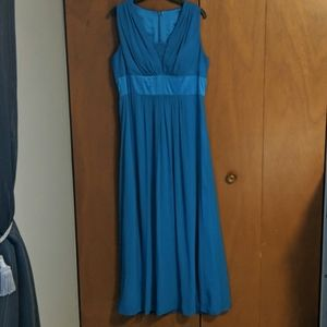 Teal blue long sleeveless gown,